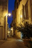 Narrow street with flowers in the old town Mougins in France. Ni. Ght view stock images
