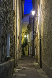 Narrow street with flowers in the old town Mougins in France. Ni. Ght view Stock Image