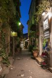 Narrow street with flowers in the old town Mougins in France. Ni Royalty Free Stock Photos