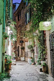 Narrow street with flowers in the old town Mougins in France. Ni Royalty Free Stock Image