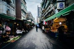 Narrow street with food vendors near Dongmen, Taipei, Taiwan. Royalty Free Stock Images