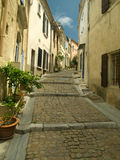 Narrow street in French town. Narrow medieval street in French town Stock Images