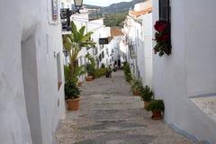 Narrow Street in Frigiliana an old Moorish village above Nerja on the Costa del Sol in Southern Spain Stock Image