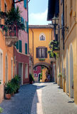 Narrow street in Gardone Stock Images