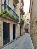 Narrow street in Girona, Catalonia Royalty Free Stock Photography