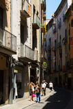 Narrow street of Girona, Spain Stock Images