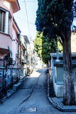 Narrow street going up the hill in the seaside town Royalty Free Stock Images