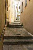 Narrow street going up in a town from Tuscany Stock Photo