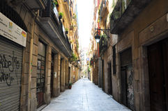 Narrow street in the Gothic Quarter of Barcelona. Royalty Free Stock Images