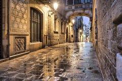 Narrow street in gothic quarter, Barcelona. Narrow street Carrer del Bisbe in gothic quarter, Barcelona, Spain Stock Photo