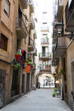 Narrow street in the Gothic quarters of Barcelona Royalty Free Stock Images