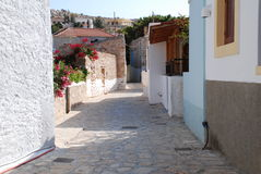 Narrow street, Halki island Stock Photos
