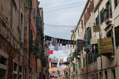 Narrow Street with Hanging Washing Royalty Free Stock Photo