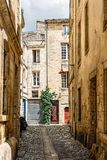 Narrow street in historic city centre of Bordeaux. Narrow cobblestoned street in historic city centre of Bordeaux, France stock photography