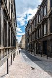 Narrow street in historic city centre of Bordeaux. France royalty free stock photography