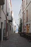 Narrow street in historical center of Cadaques, Spain Stock Photo
