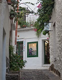 Narrow street in historical center of Cadaques, Spain Stock Photography
