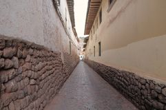 Narrow street in the historical center of Cuzco Stock Images
