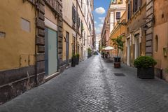 Narrow street in the historical centre of Rome, Italy royalty free stock images