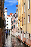 Narrow street. Houses over the channel. Venice Stock Photos