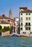 Narrow street. Houses over the channel. Venice Stock Photo