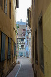 Narrow street between the houses Royalty Free Stock Photography
