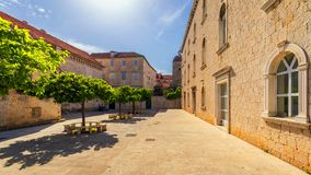 Narrow Street In Historic Town Trogir, Croatia. Travel Destination. Narrow Old Street In Trogir City, Croatia. The Alleys Of The Stock Image