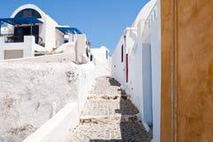 The narrow street on the island of Santorini, Oia. Greece. Royalty Free Stock Photography