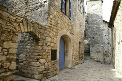 Narrow street of Lacoste. Town in France Stock Photos