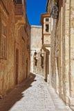 Narrow street with lantern and balcony at Mdina old town. Malta Stock Photo