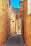 Narrow street with lantern and balcony in Mdina old town. Malta Royalty Free Stock Photography