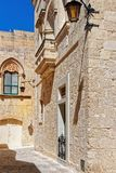 Narrow street with lanterns in Mdina. Malta Royalty Free Stock Photo