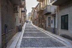 Narrow street of Lascari in Sicily, Italy. Sunny streets of Italian city Lascari in Sicily, Italy Royalty Free Stock Photos
