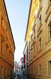 A narrow street laying through bratislava castle. Between yellow old historical buildings stock photography