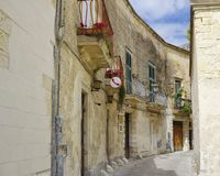 Narrow street leading to the square of the famous basilica Church of the Holy Cross. stock images