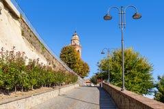 Narrow street and autumnal trees in small italia, town. Royalty Free Stock Photos