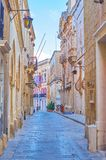 The old street in Mdina, Malta. The narrow street leads along lines of old medieval stone edifices in Mdina fortress, Malta royalty free stock images