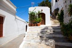 Narrow street in Lindos.Rhodes island Stock Photo