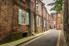 Narrow Street Lined with Terraced Houses Royalty Free Stock Image