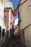 Narrow street in Lisbon Royalty Free Stock Image