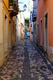 Narrow street at Lisbon, Portugal Royalty Free Stock Photo
