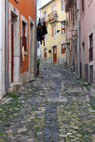 Narrow street at Lisbon, Portugal Stock Photo