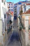 Narrow street of Lisbon Stock Photos
