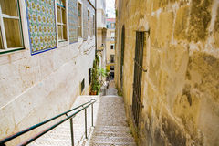 Narrow street of Lisbon, Portugal. Royalty Free Stock Images