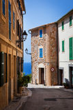 Narrow street, Majorca, Spain. Narrow street old traditional houses village with sea view,  Banyalbufar, Majorca, Spain Royalty Free Stock Image