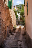 Narrow street, Majorca, Spain. Narrow street old traditional houses village with stairs, Banyalbufar, Majorca, Spain Royalty Free Stock Photos