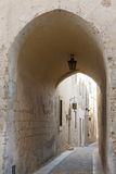 Narrow street, Malta. A narrow gangway street in Valletta, Malta Stock Images