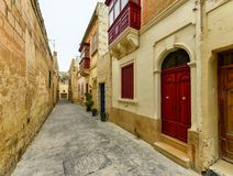 Narrow street in Malta. Mdina city street view. It is a fortified city in the Northern Region of Malta, which served as the island`s capital from antiquity to Royalty Free Stock Photos