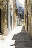 Narrow street on Malta. Typical narrow street on the island of Malta. Buildings with traditional colorful maltese balconies in historical part of Valletta Royalty Free Stock Image
