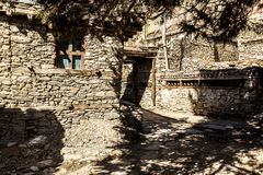 Narrow street in Manang - mountain village in Nepal. Himalayas, Annapurna Conservation Area.  royalty free stock images